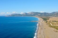 Aerial view over Dalaman beach in Turkey. Aerial view over Dalaman beach toward Sarigerme on the Meditteranean coast of Turkey Royalty Free Stock Photography