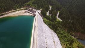 Aerial view over the dam of lake stock footage