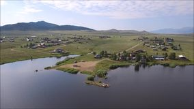 Aerial view over Deweese Reservoir, Colorado. Aerial pan over Deweese Reservoir in Colorado countryside stock video