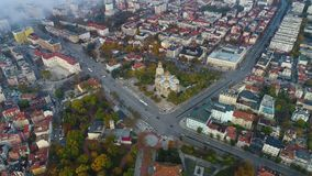 Aerial view over downtown in Varna city, Bulgaria. Street traffic, The Cathedral and The Theatre stock video
