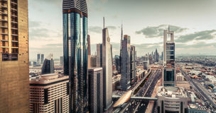 Aerial view over Dubai`s famous architecture with highway and skyscrapers Royalty Free Stock Photography