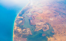 Aerial view over Earth Sea and Coast ,View from the airplane . Royalty Free Stock Photo