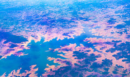 Aerial view over Earth Sea and Coast ,View from the airplane . Stock Image