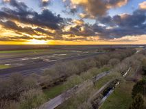 Aerial View over fields on dutch countryside. Under beautiful sunset in winter in Groningen Province, Netherlands royalty free stock photos