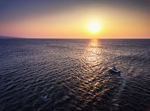 Aerial view over Fishing boat on the water and beautiful sunrise Royalty Free Stock Images