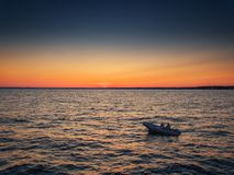 Aerial view over Fishing boat on the water and beautiful sunset Royalty Free Stock Images