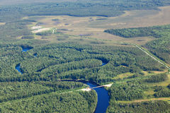 Aerial view over the forest river with bridge Stock Photography