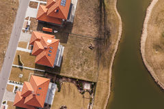 Aerial view over golf field and houses Stock Photography