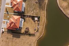 Aerial view over golf field and houses Stock Photo