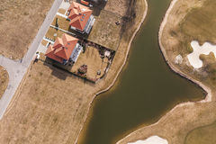 Aerial view over golf field and houses Stock Image