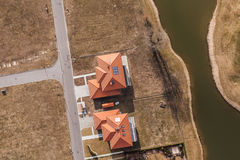 Aerial view over golf field and houses Royalty Free Stock Images