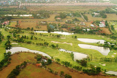 Aerial view over golf green field stock photo