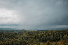 Aerial view over the green forest in evening. Cloudy mystery. Landscapes of Latvia. Stock Images