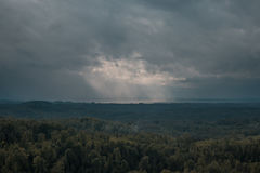 Aerial view over the green forest in evening. Cloudy mystery. Landscapes of Latvia. Stock Photography