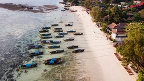 Aerial view over group of long tail boats in sunrise beach. Koh Lipe island, Satun, Thailand stock photo