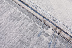 Aerial view  over the harvest fields in winter Stock Photo