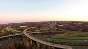 Aerial view over highways and landscape stock footage