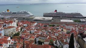 Aerial view over the historic Alfama district of Lisbon - CITY OF LISBON, PORTUGAL - NOVEMBER 5, 2019 stock footage