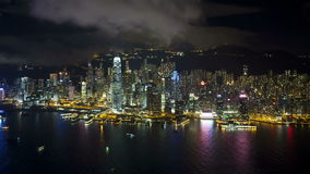 Aerial view over hong kong island looking towards victoria peak showing stock video