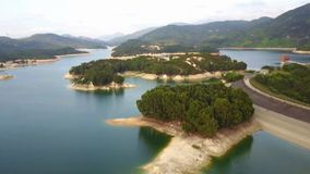 Aerial view over Hong Kong Tai Lam Chung Reservoir under smokey weather.  stock footage