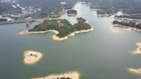 Aerial view over Hong Kong Tai Lam Chung Reservoir under smokey weather.  stock video footage