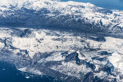 Aerial view over ice mountains in Greenland Royalty Free Stock Image
