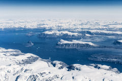 Aerial view over ice mountains in Greenland Royalty Free Stock Images