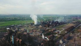 Aerial view over industrialized city with air atmosphere and river water pollution from metallurgical plant near sea stock footage