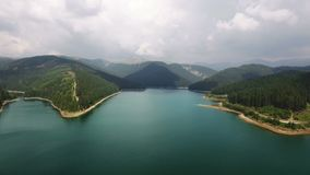 Aerial view over lake and mountains 3 stock video footage