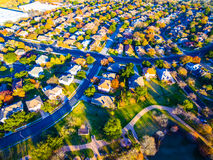 Aerial View Over Modern Suburb Home Community with Fall Colors Royalty Free Stock Photography