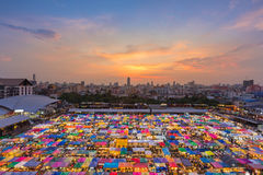 Aerial view over multiple color weekend market roof top Stock Images
