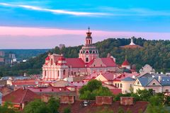 Old town at sunset, Vilnius, Lithuania. Aerial view over Old town with Church of St Casimir and Three Crosses on the Bleak Hill at sunset, Vilnius, Lithuania stock images