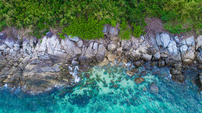 Aerial view over palm trees, rocks and sea in Phuket Stock Image