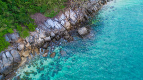 Aerial view over palm trees, rocks and sea in Phuket Royalty Free Stock Photography