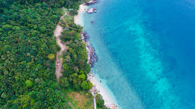 Aerial view over palm trees, rocks and sea in Phuket Stock Images