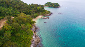 Aerial view over palm trees, rocks and sea in Phuket Royalty Free Stock Photo