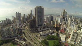 Aerial view over Panama City high rise buildings stock video