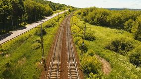 Aerial view over railway. Aerial view railway in the countryside. Railway and highway, aerial footage, 4k stock video footage