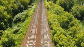 Aerial view over railway. Aerial view railway in the countryside. Railway and highway, aerial footage, 4k stock footage