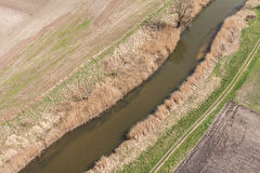 Aerial view of  over the  river and harvest fields. Aerial view of  over the river and harvest fields in Poland Stock Images