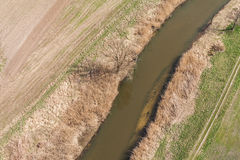 Aerial view of  over the  river and harvest fields. Aerial view of  over the river and harvest fields in Poland Stock Image