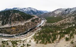 Aerial view over river and mountains panorama