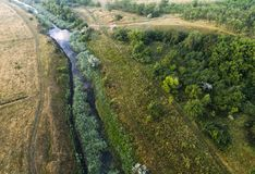Aerial view over the river stream. Royalty Free Stock Image