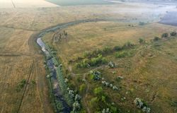 Aerial view over the river stream. Stock Photo