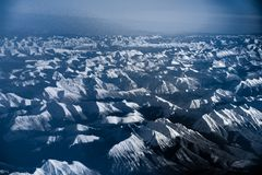 Aerial view over the rocky mountains from the airplane Stock Image