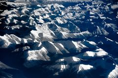 Aerial view over the rocky mountains from the airplane Royalty Free Stock Photography