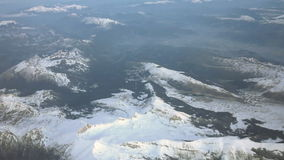 Aerial view over snowy mountains stock video footage