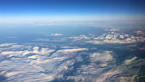 Aerial view over the snowy mountains of Northern Norway stock footage