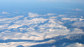 Aerial view over the snowy mountains of Northern Norway stock video footage