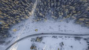 Aerial view over snowy road Royalty Free Stock Photos
